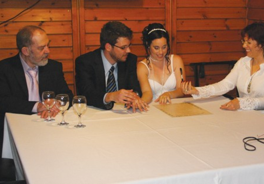 Rabbi Galit Oren-Moran conducts a wedding ceremony