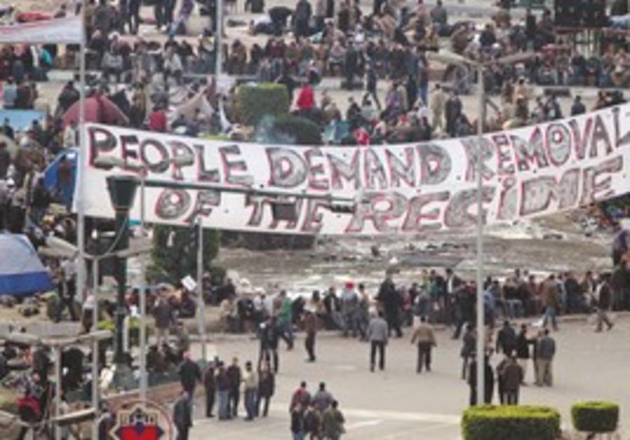 ANTI-MUBARAK protestors gather in Tahrir Square th