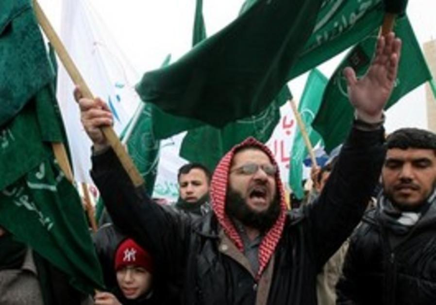 Jordanian opposition protesters shout slogans