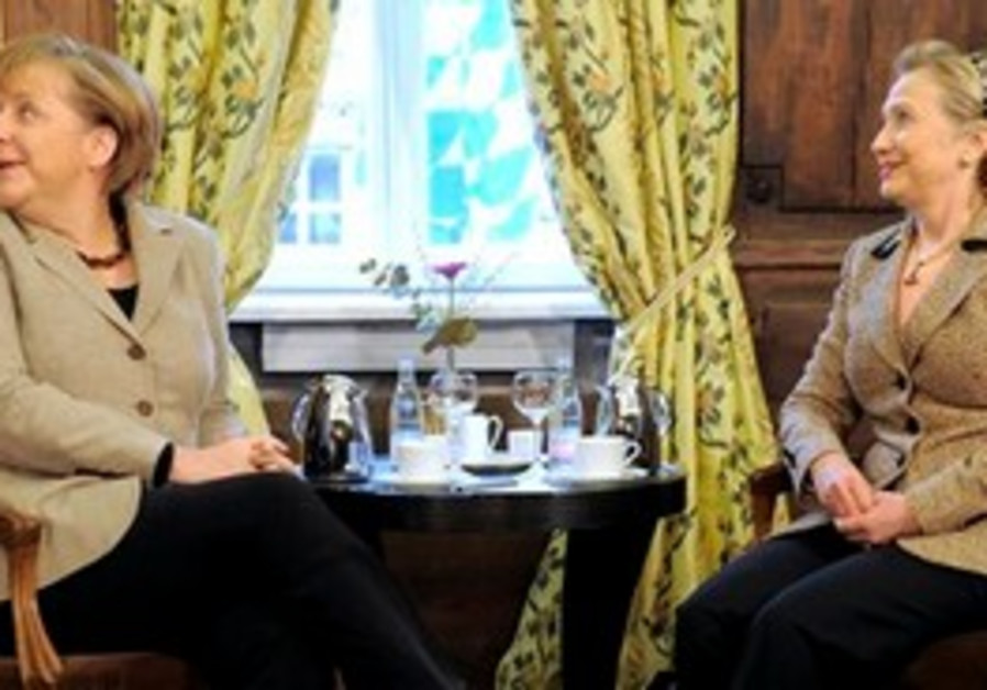 Clinton and Merkel at Munich security conference