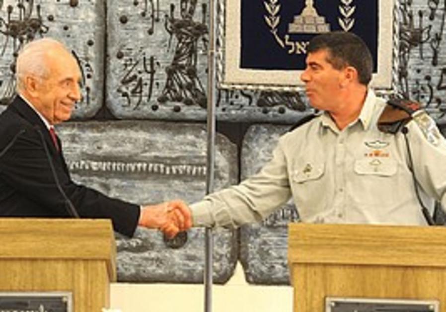 Peres and Ashkenazi shake hands, Monday