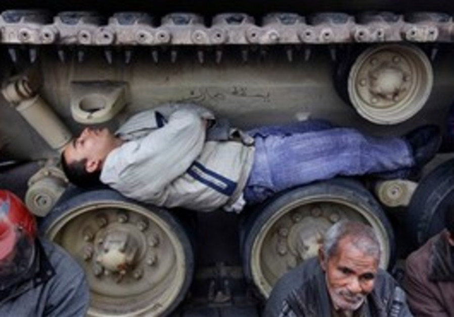Egyptian man sleeps in tank tracks
