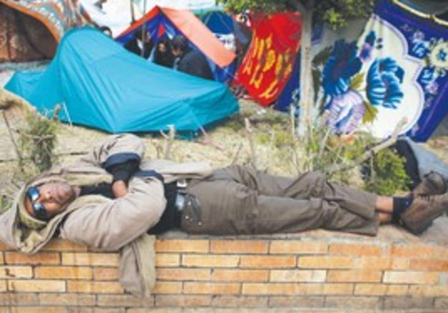 Anti-Gov't protester sleeps in Tahrir Square