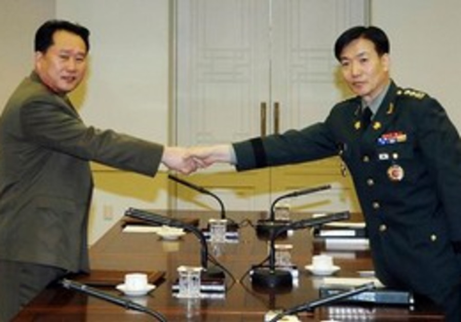 North and South Korea delegate army colonels.