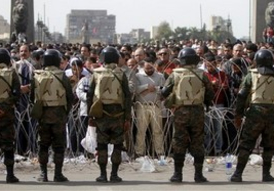 Egyptian troops and protesters in Tahrir Square