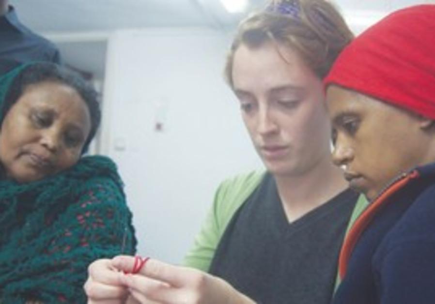 volunteer Kayla Zecher teachers how to croche