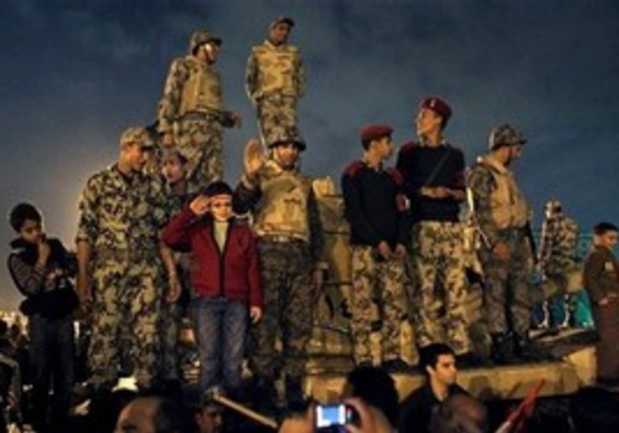 Egyptian soldiers celebrate in Tahrir Square