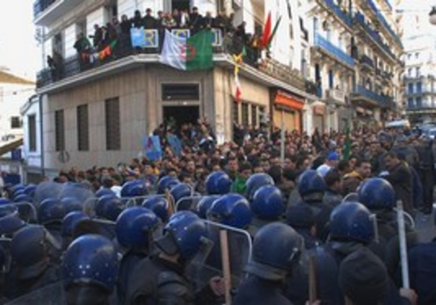 Algerian riot police brace for banned rally