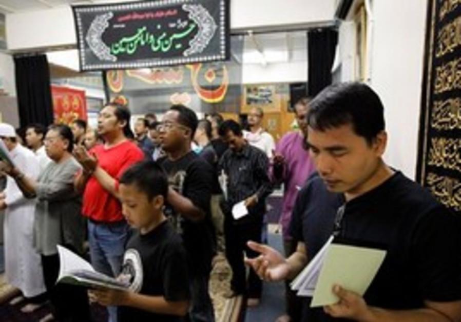 Malaysian men praying
