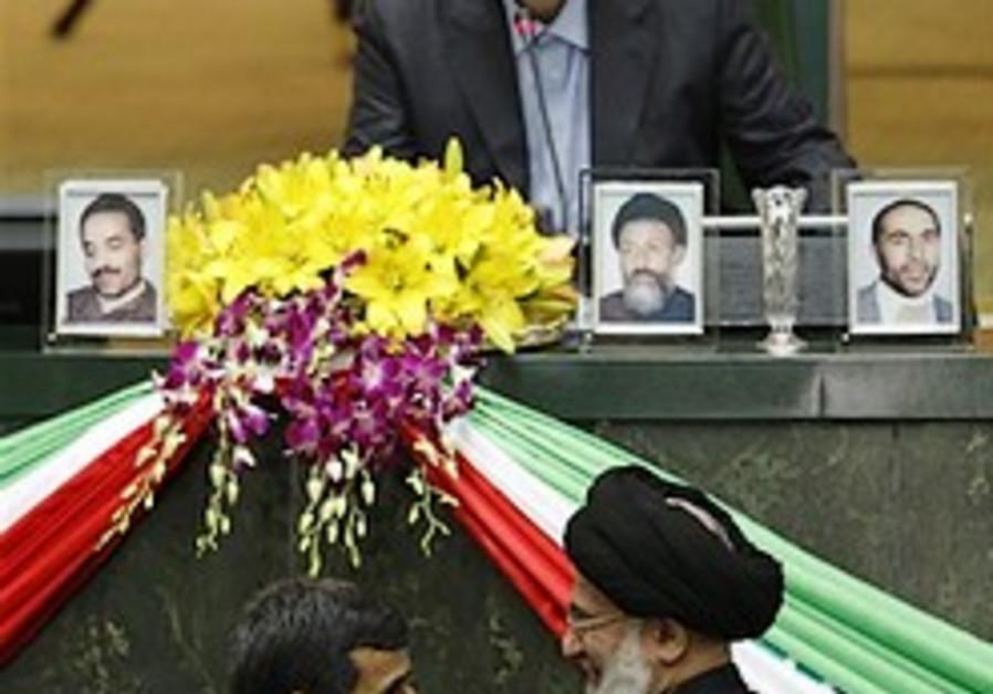 Iranian President Mahmoud Ahmadinejad, bottom left