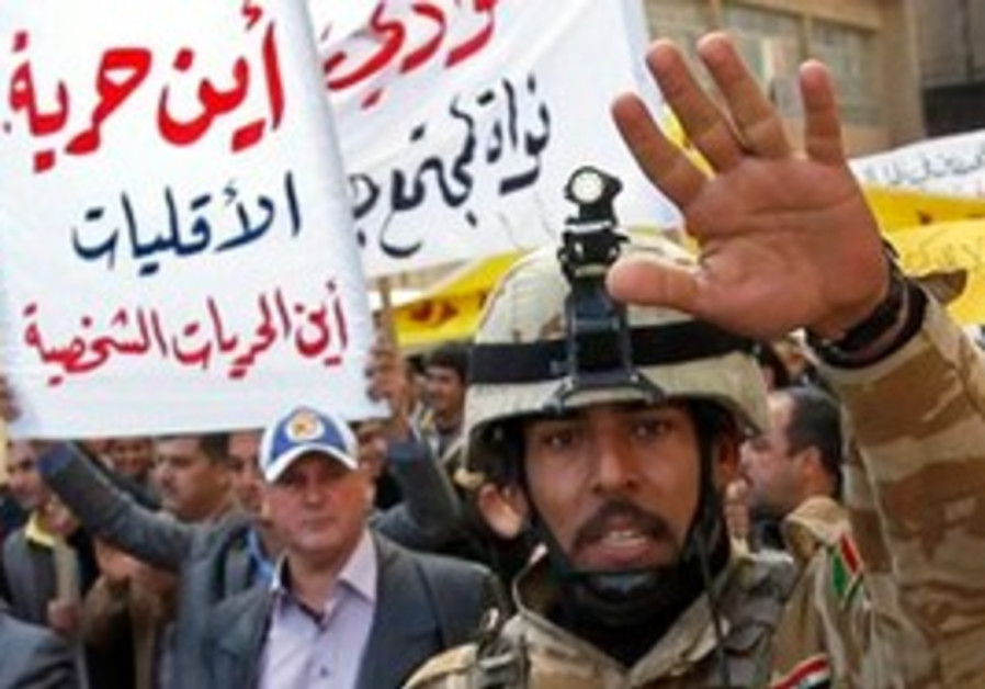 Iraq police try to contol protesters
