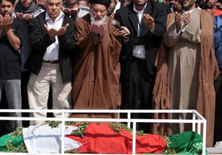 Mourners pray at funeral for fallen protester in B