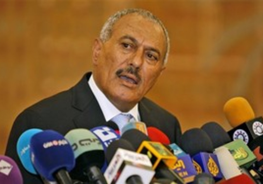 Saleh speaks to the press in Sanaa, Yemen, Monday