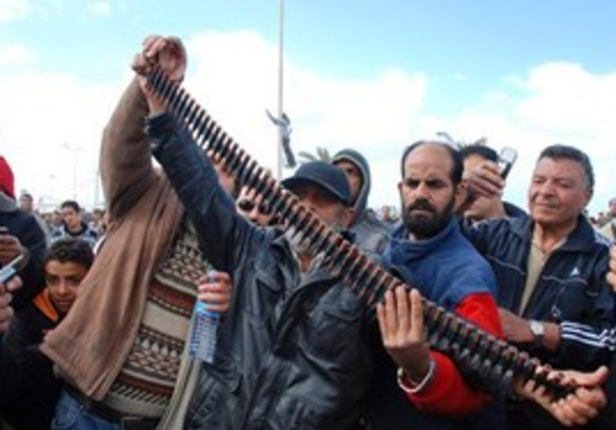 Angry anti-gov't Libyan protesters hold bullets