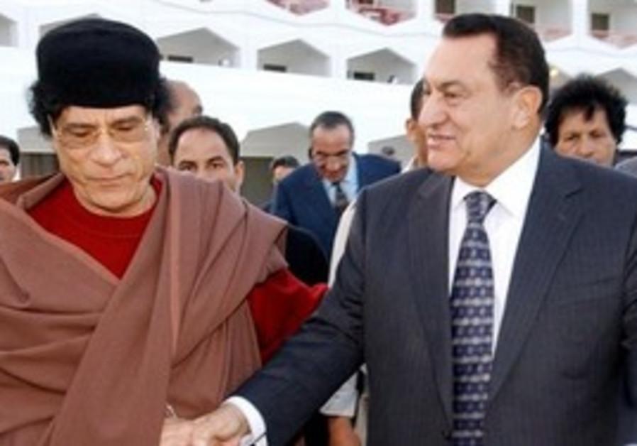 Muammar Gaddafi with Hosni Mubarak [file photo]