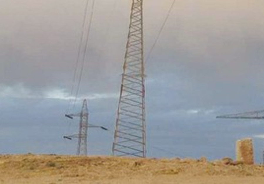 AN ELECTRICITY pole towers over the Ramon Crater