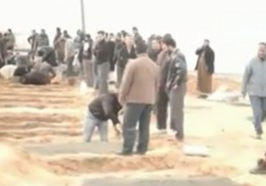 Civilians digging mass graves in Libya.