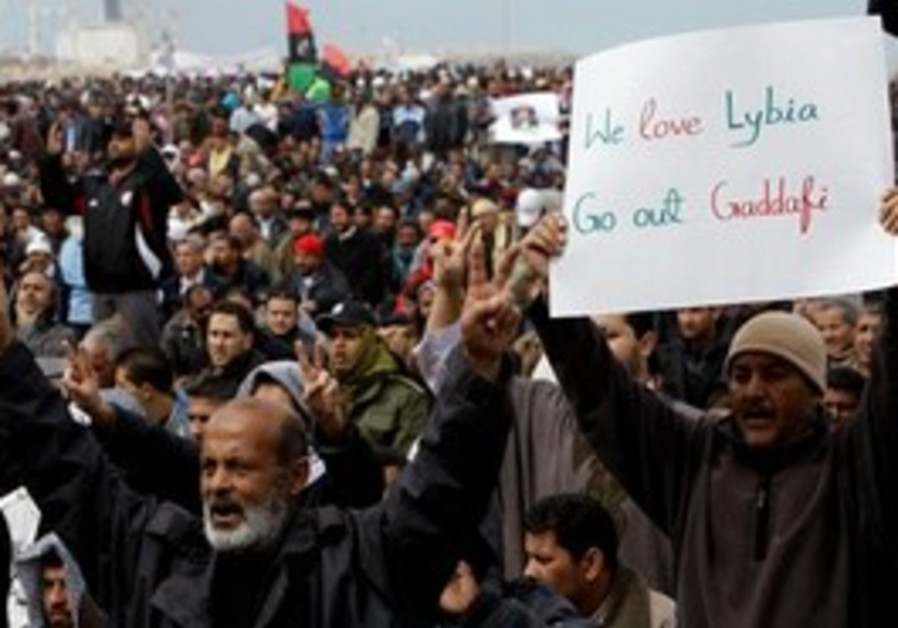 Libyan protesters shout slogans against Gaddafi