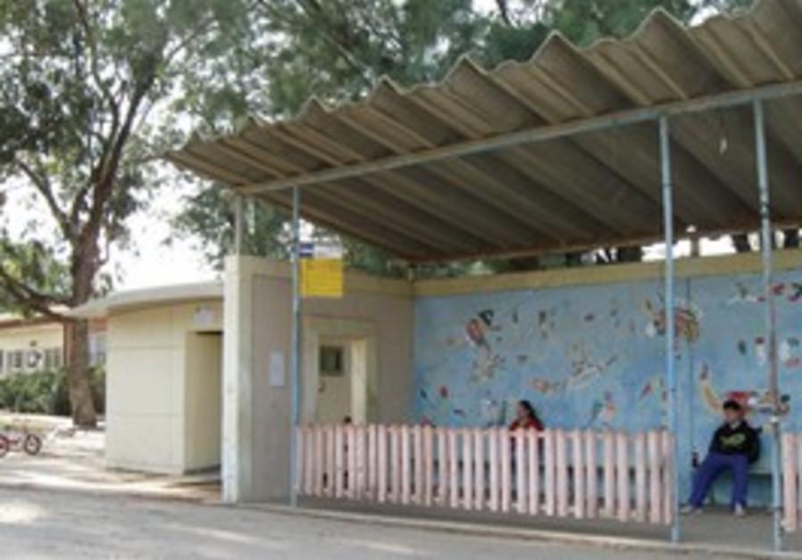 Bus stop at Kibbutz Kfar Aza has bomb shelters.