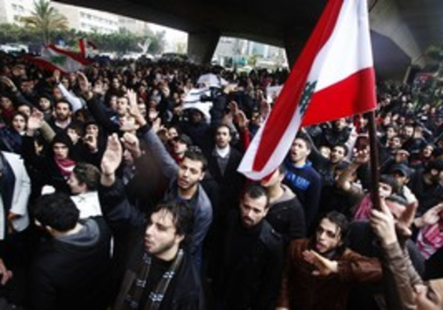 Protesters at a demonstration in Beirut, yesterday