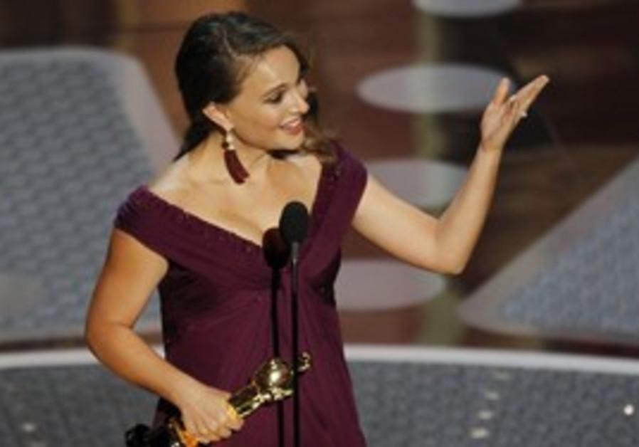Natalie Portman accepts the Oscar for best actress