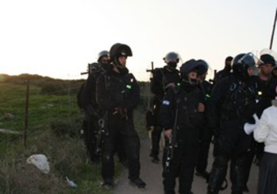 Police monitor protestors at Gilad Farm demolition