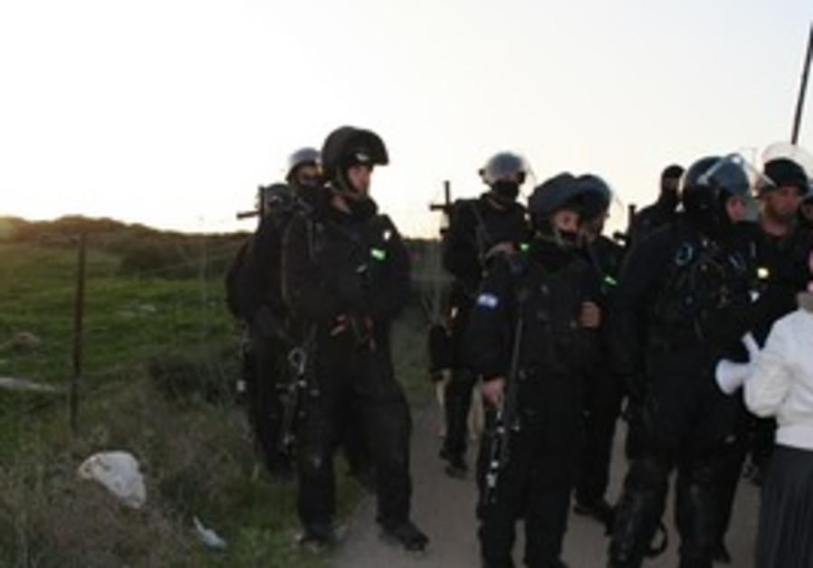 Police monitor protestors at Gilad Farm demolition