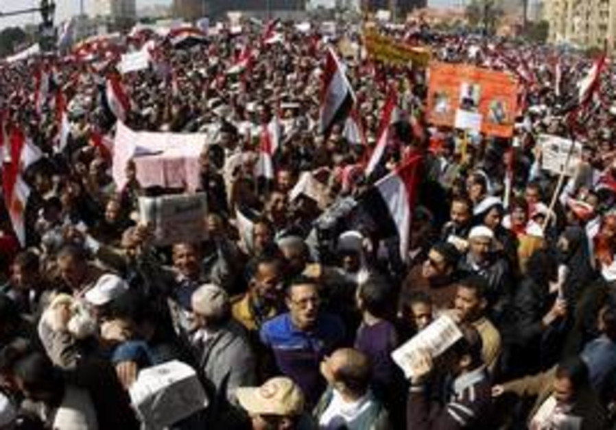 Pro-democracy protesters gather in Tahrir Square