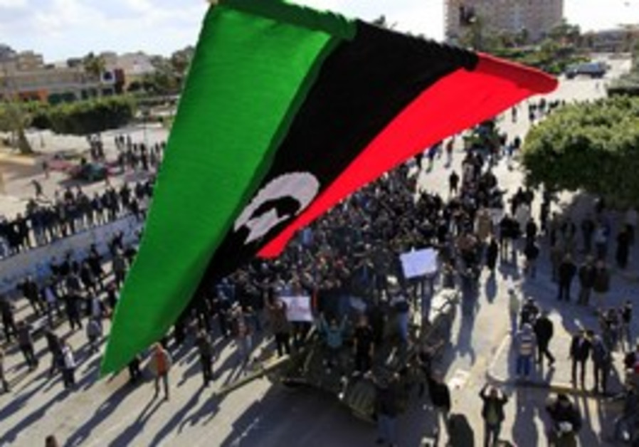 Libyan flag seen over protesters in Zawiyah.