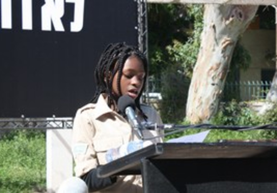 Esther Aikpehae speaks at a rally in Tel Aviv.