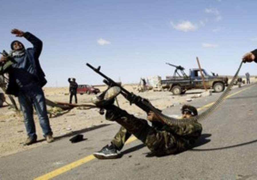 Libyan rebel firing at helicopter