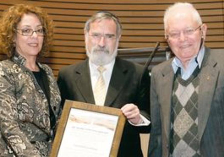 CHIEF RABBI Lord Sacks receives award