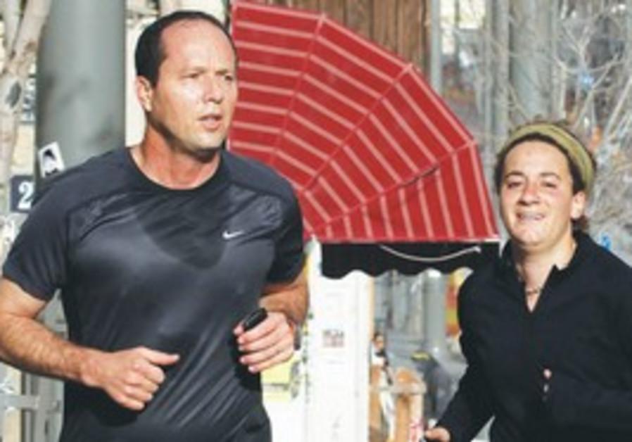 The JPost's Melanie Lidman runs with Mayor Barkat.