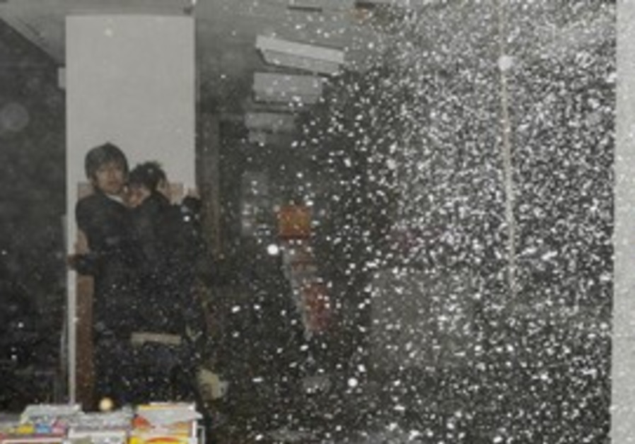 People take shelter as ceiling collapses in Japan