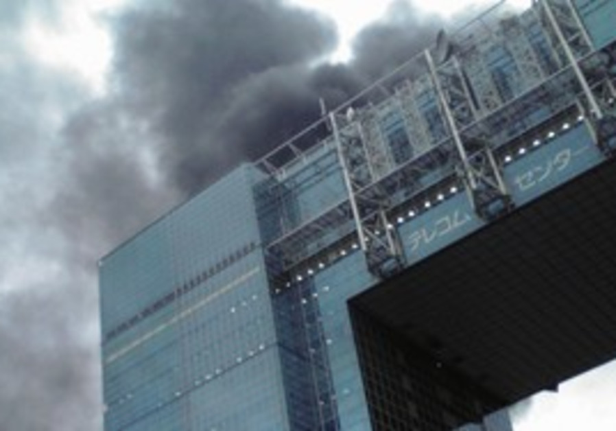 A building burns in Tokyo after the quake hits.