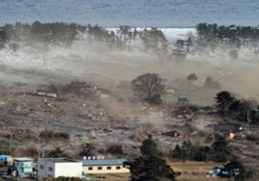 Houses are swept by a tsunami in northeast Japan.