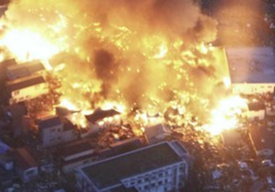 Houses burn after earthquake in Yamada, Japan
