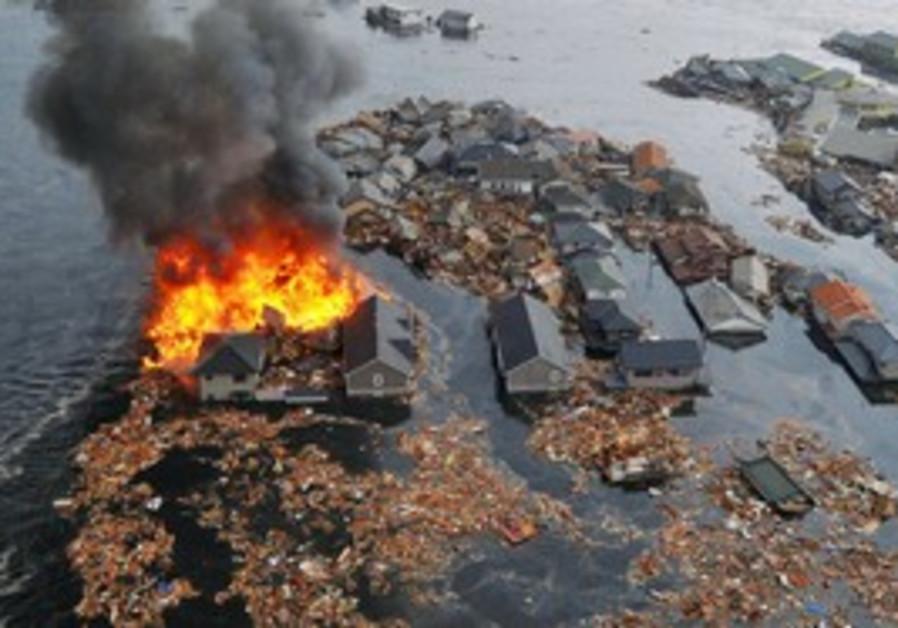 House burns after earthquake, tsunami in Japan