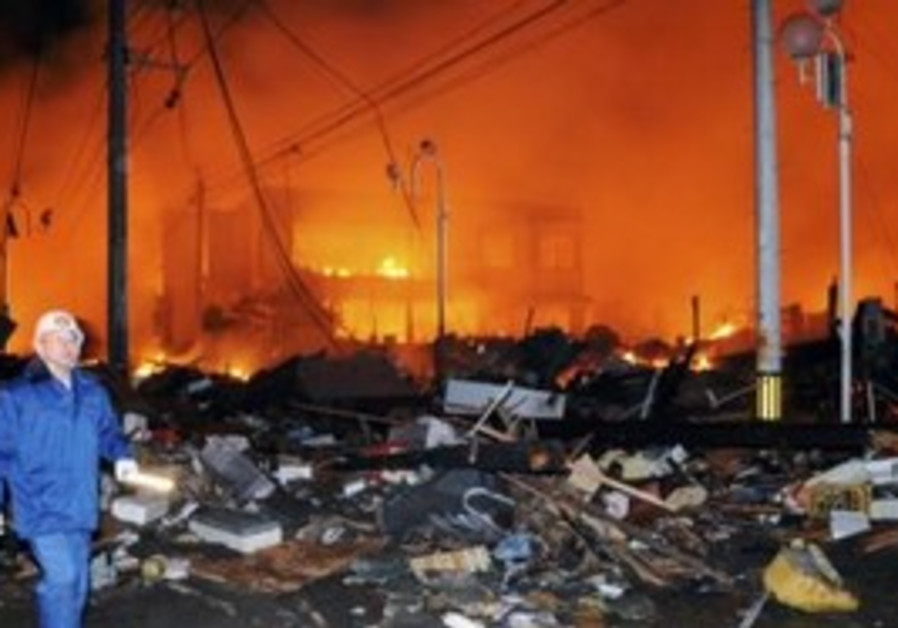 Flattened, burning homes after earthquake in Japan