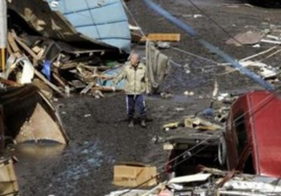 Man surveys tsunami damage in Japan
