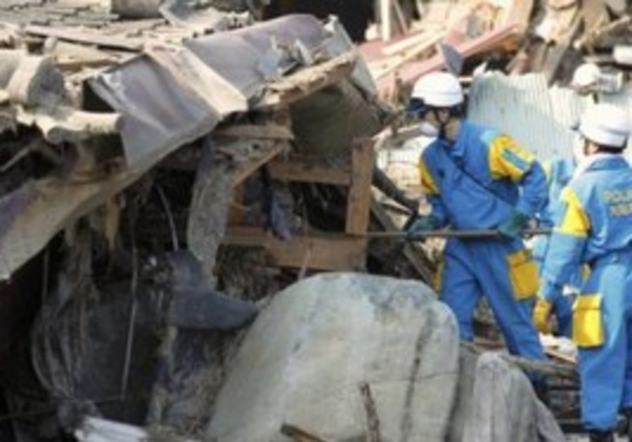 Rescue workers searching through rubble in Japan