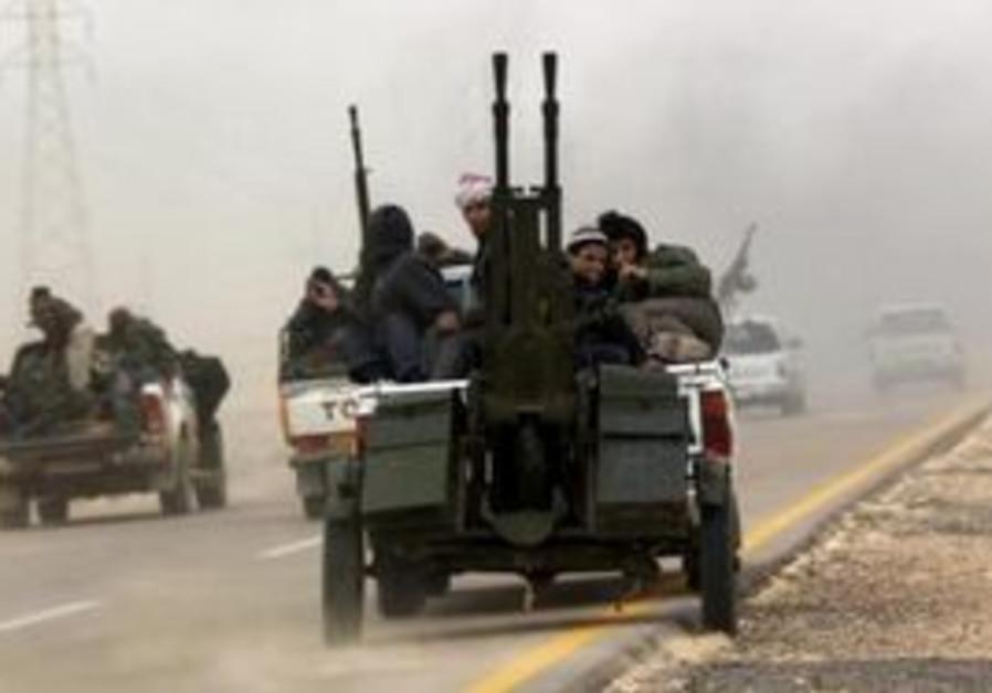 Libyan rebels fleeing