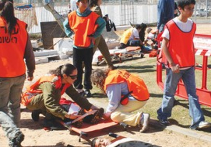 RESCUE PERSONNEL tend to 'casualties' in a drill