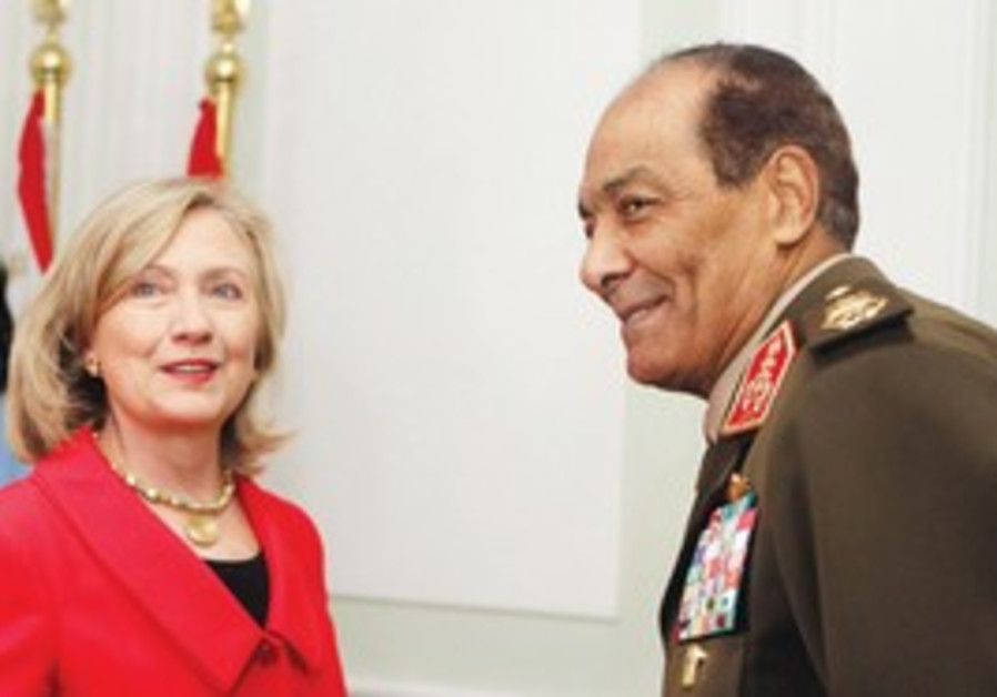 MOHAMED HUSSEIN TANTAWI greets Hilary Clinton
