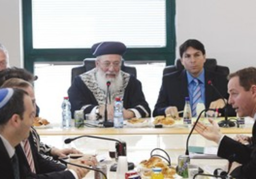 CHIEF RABBI Amar attends meeting