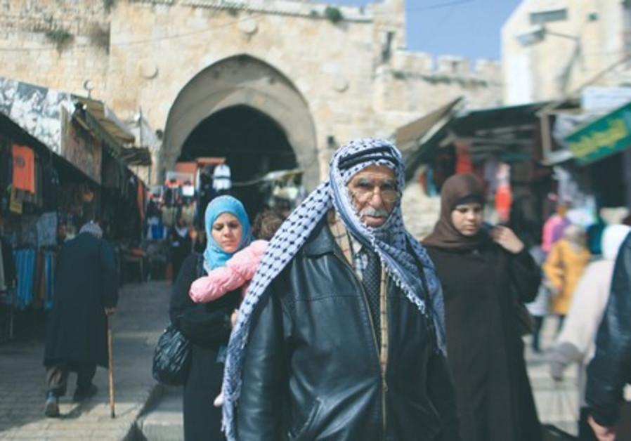 An Arab man walking in Jerusalem.