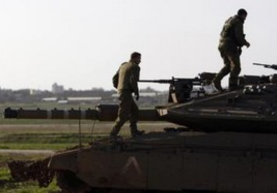 IDF soldiers on tank near Gaza border