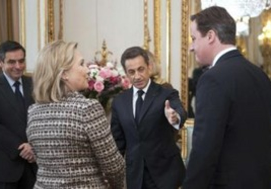 Sarkozy speaks with Clinton and Cameron in Paris.