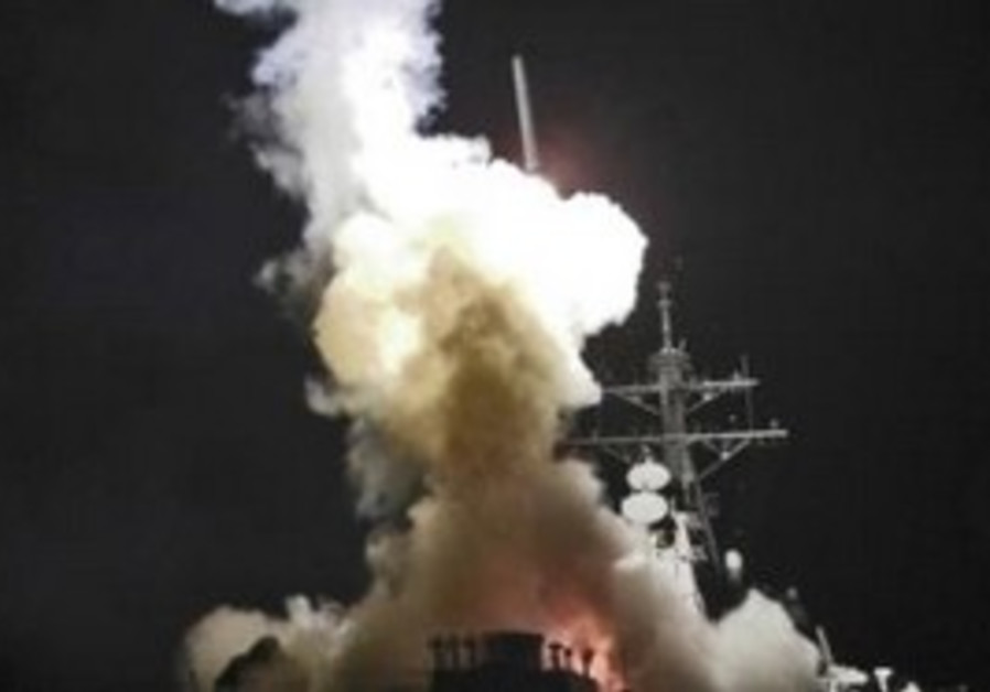 Tomahawk missile being fired from USS Barry