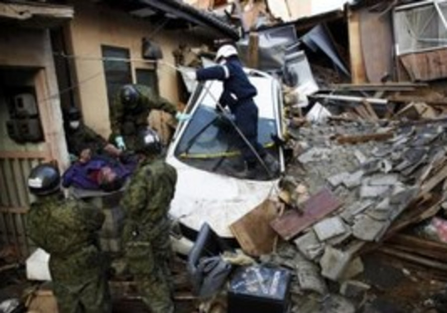 A body is pulled from rubble from Japan earthquake